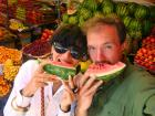 Eating water melon at the market in Sucre.